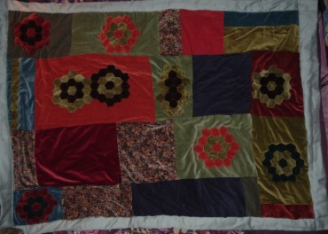 Velvet patchwork and applique throw.